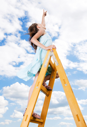 Little girl climbing ladder and pointing with her finger towards the sky and clouds. [url=http://www.istockphoto.com/search/lightbox/9786682][img]http://dl.dropbox.com/u/40117171/children5.jpg[/img][/url]